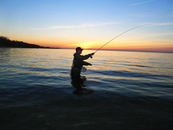 Dominik Walczak, a passionate angler and member of the OSA voluntary bailiff organisation, fly fishing for sea trout.