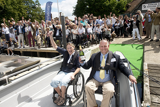 crowds cheer as the the brand new Coulam V20 wheelyboat is launched (photo credit Rob Judges)