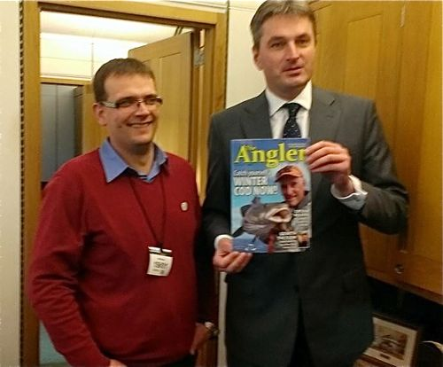 Rado Papiewski and Daniel Kawczynski MP with a copy of the Angling Trust's magazine, The Angler – essential reading for Mr Kawczynski's brief on angling issues!
