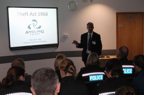 Dilip Sarkar briefing police officers at Gloucestershire Police Headquarters.
