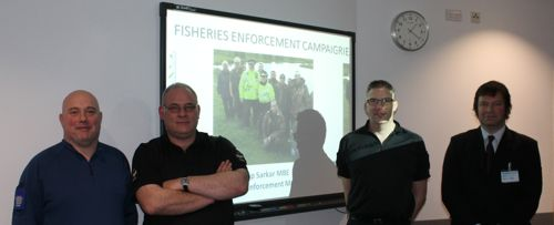 Partnership approach: PCSO Mike Shuttleworth (a keen angler!) and Sergeant Simon Clementine with a Gloucestershire Police colleague and Adrian Saunders of the Environment Agency.