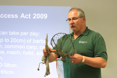 The EA's Mick Cox, demonstrating nets, lines and traps to Wiltshire Police officers.
