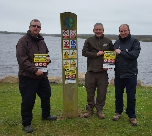 With Northumbrian water Rangers putting up Operation Traverse signs at Scaling Dam.